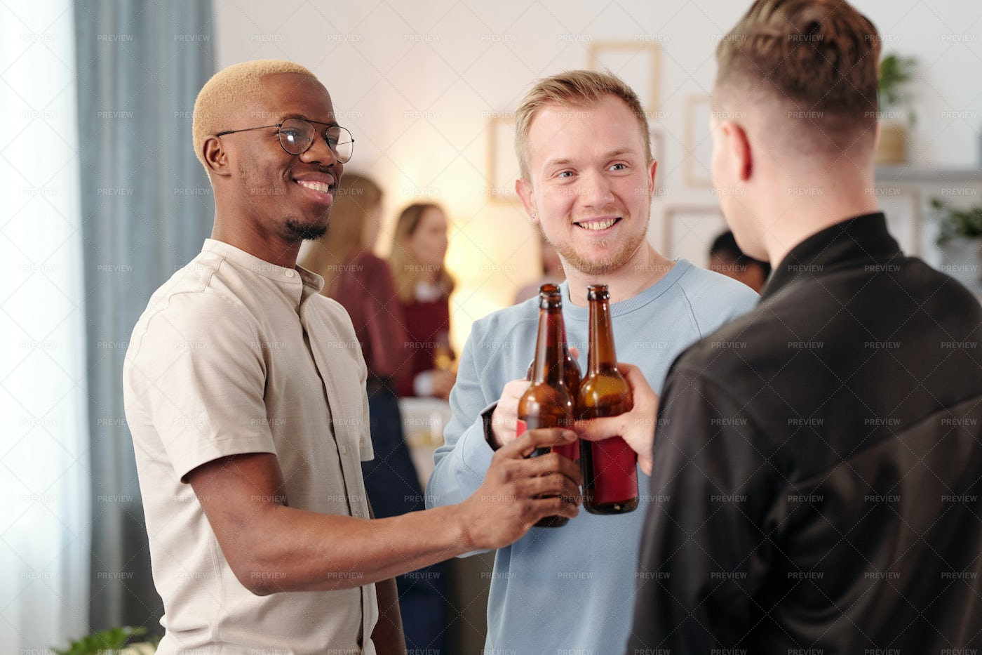 Guys Clinking With Beer: Stock Photos