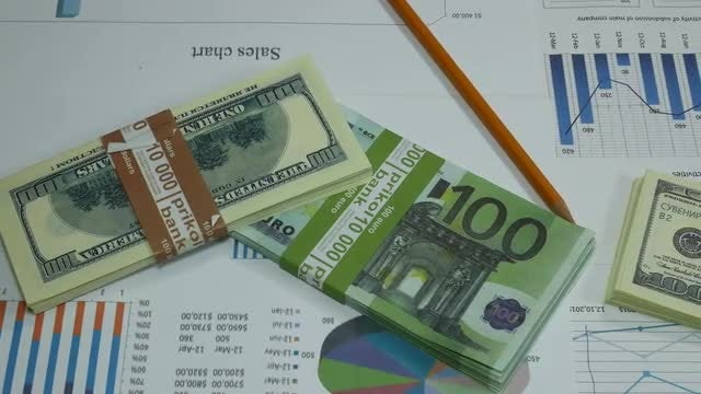 Business Charts And Dollar Bills: Stock Video