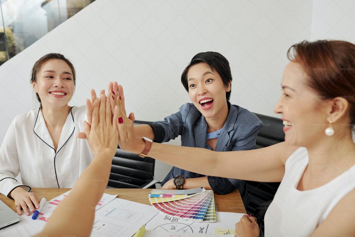 Businesswomen Giving High Five: Stock Photos