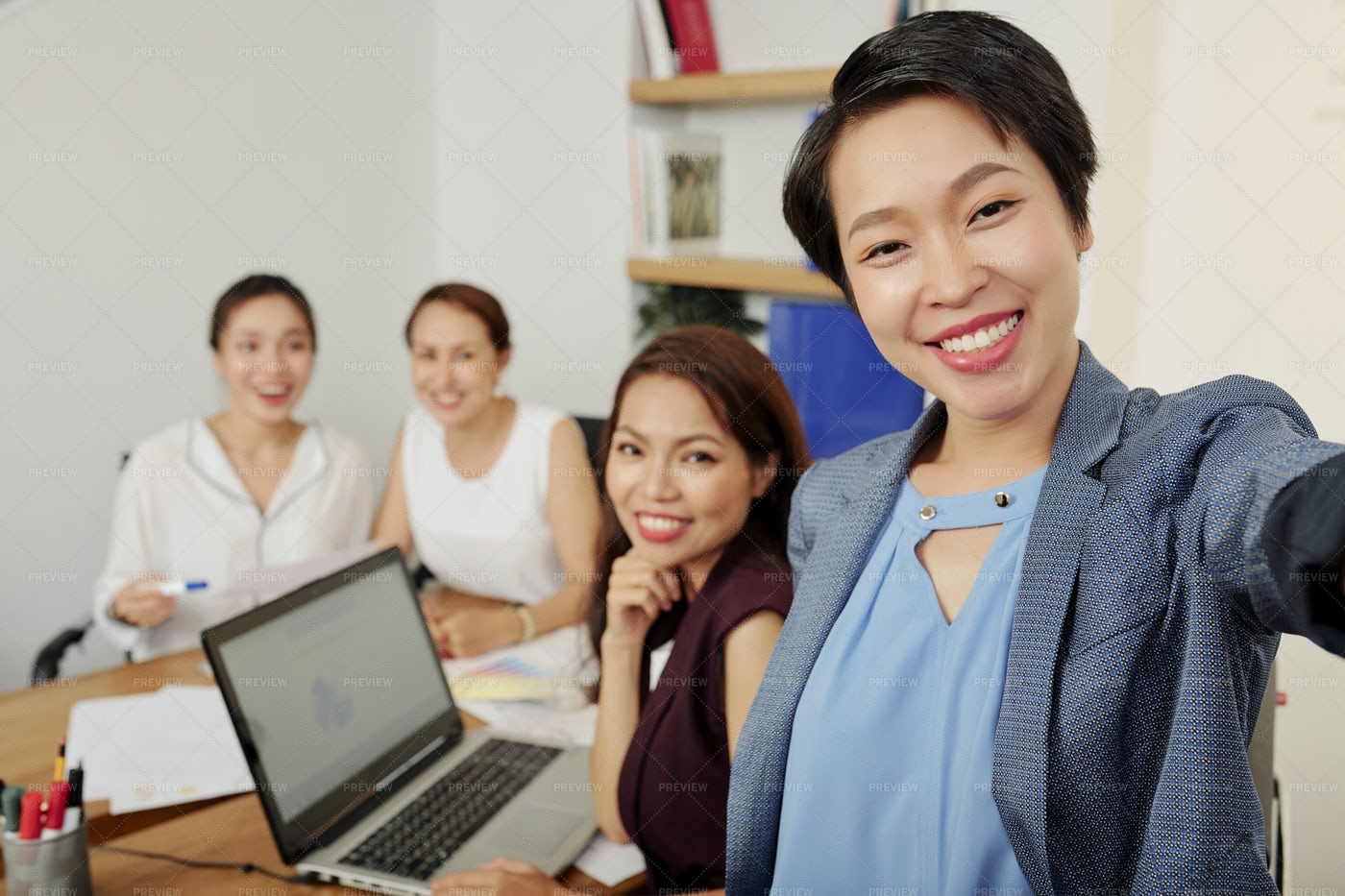 Businesswoman Photographing With Team: Stock Photos