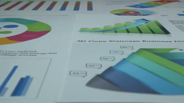 Business Charts On The Table: Stock Video