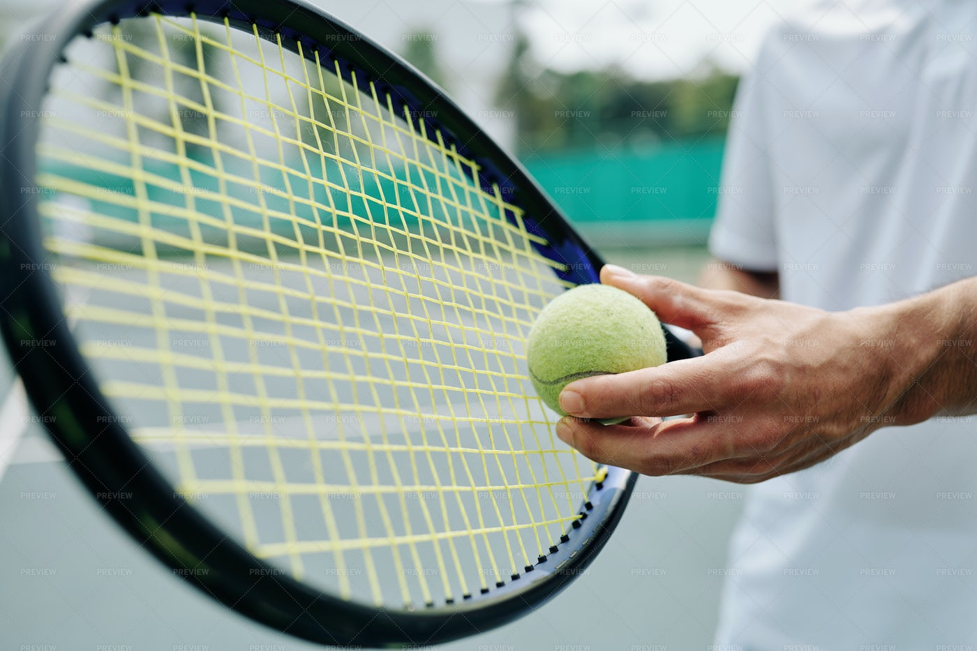 Tennis Player Serving Ball: Stock Photos