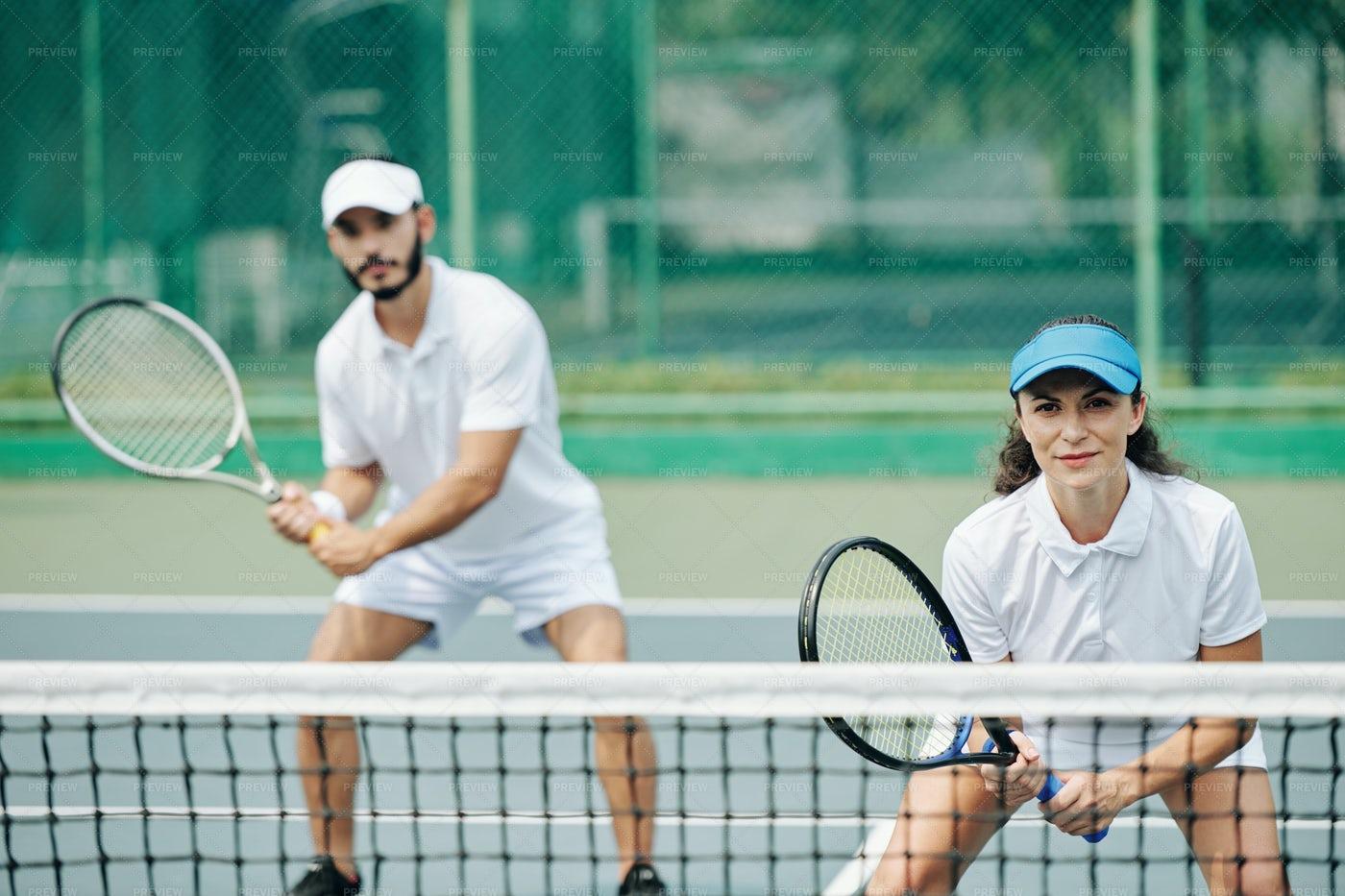 Couple Playing Tennis: Stock Photos