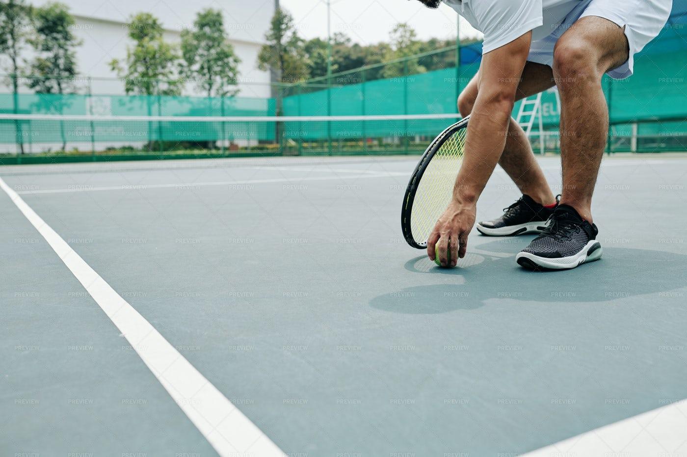 Tennis Player Taking Ball: Stock Photos