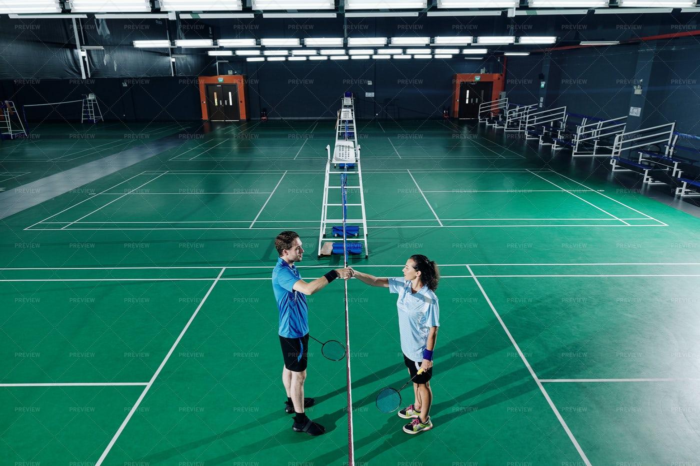 Badminton Players Training In Gymnasium: Stock Photos