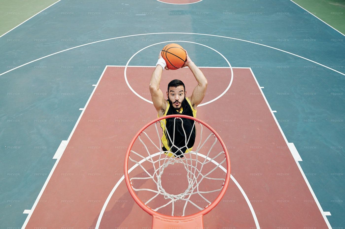 Player Throwing Ball In Basket: Stock Photos