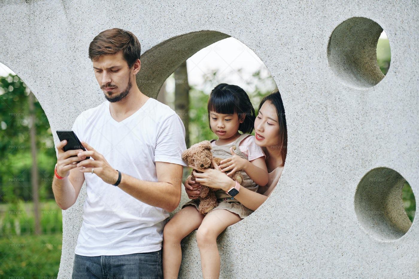 Man Texting At Playground: Stock Photos