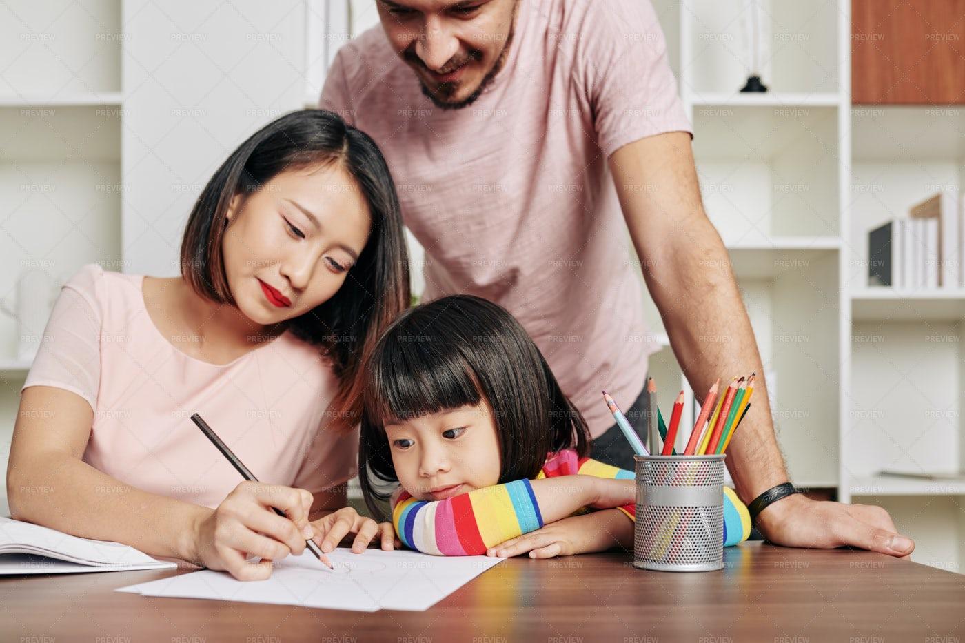 Parents Teaching Daughter: Stock Photos