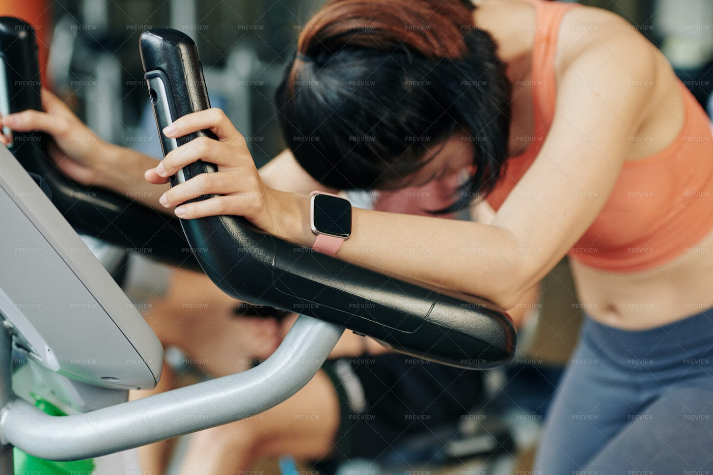 Tired Woman In Elliptical Trainer: Stock Photos