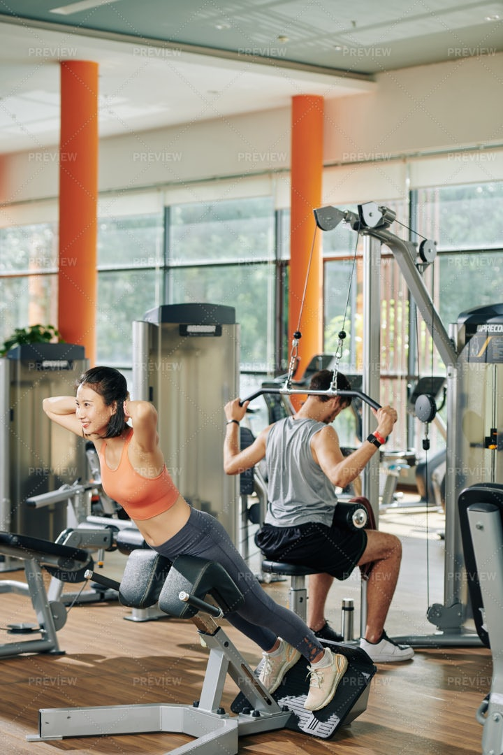 Young People Exercising In Gym: Stock Photos