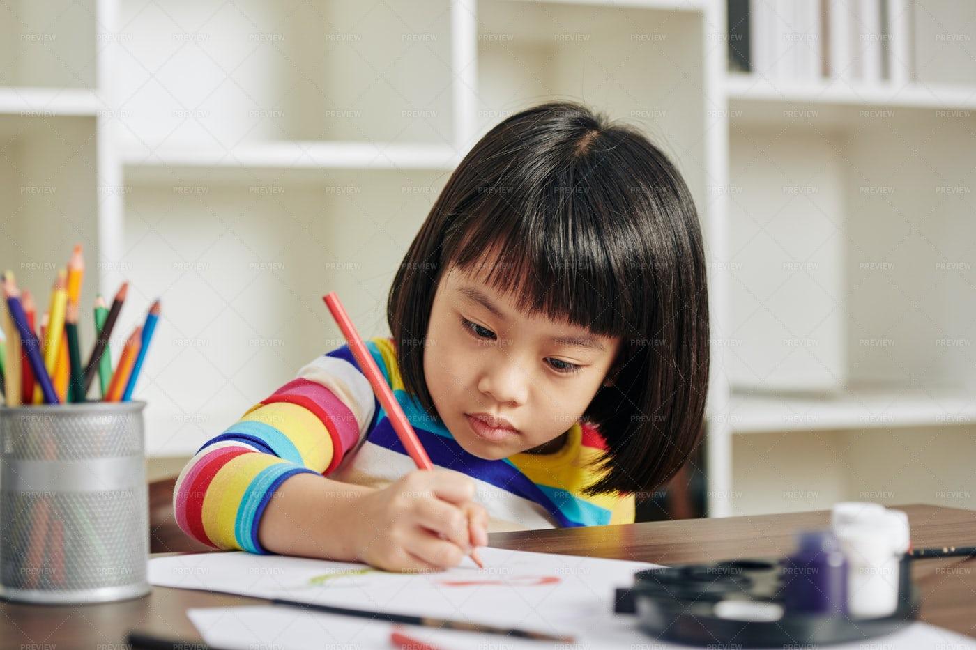 Serious Drawing Girl: Stock Photos