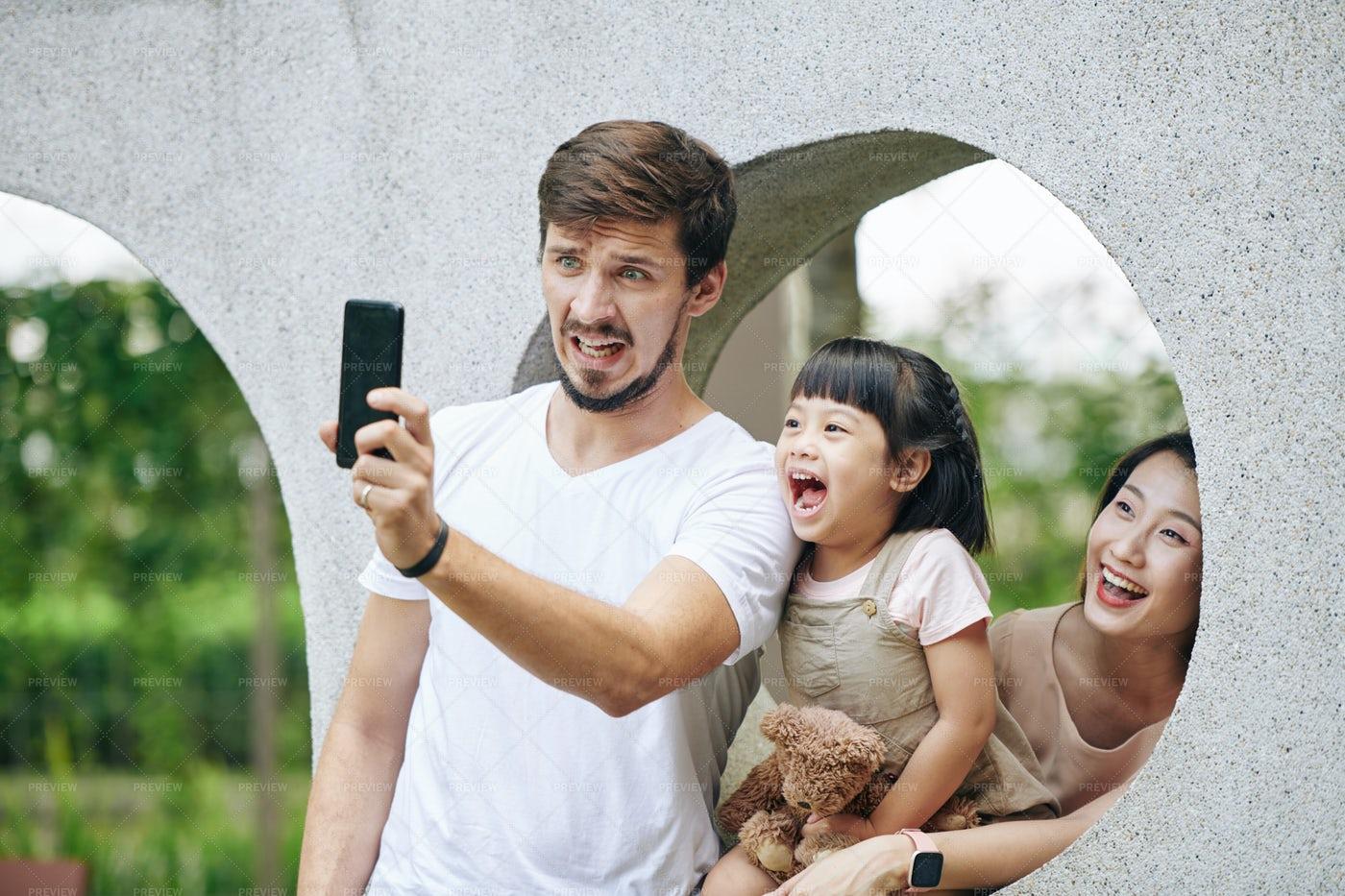 Family Taking Funny Photo: Stock Photos