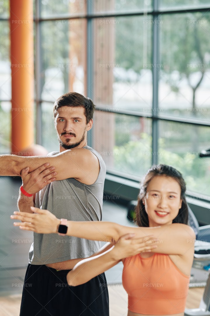 Young People Stretching Arms: Stock Photos