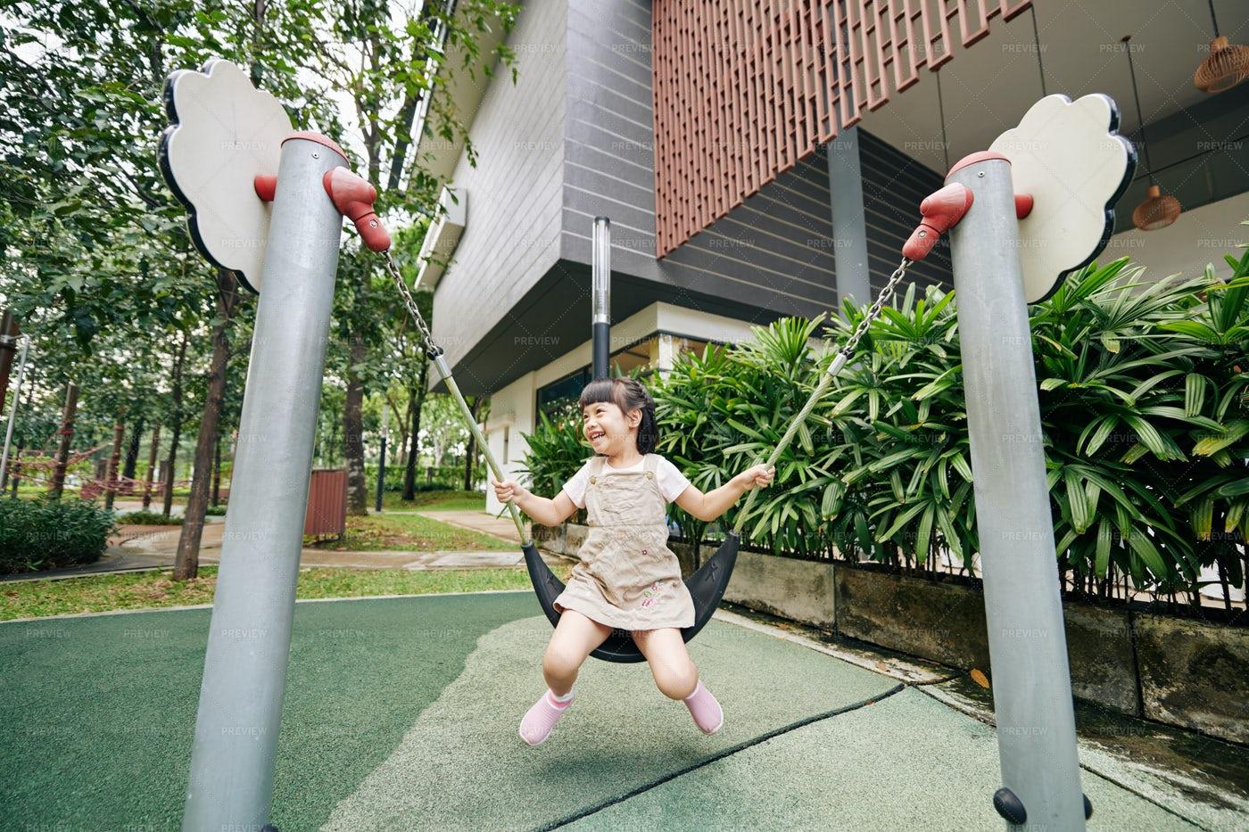Girl Swinging On Playground: Stock Photos