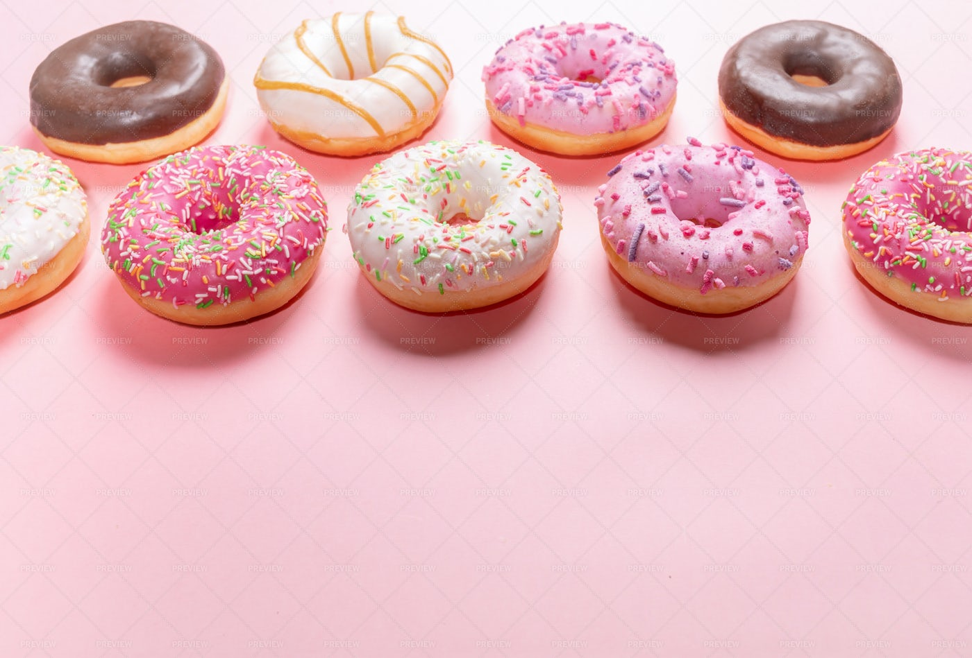 Doughnuts On Pink With Copy Space.: Stock Photos