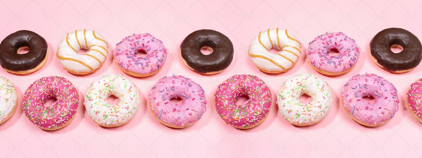 Row Of Doughnuts On Pink.: Stock Photos