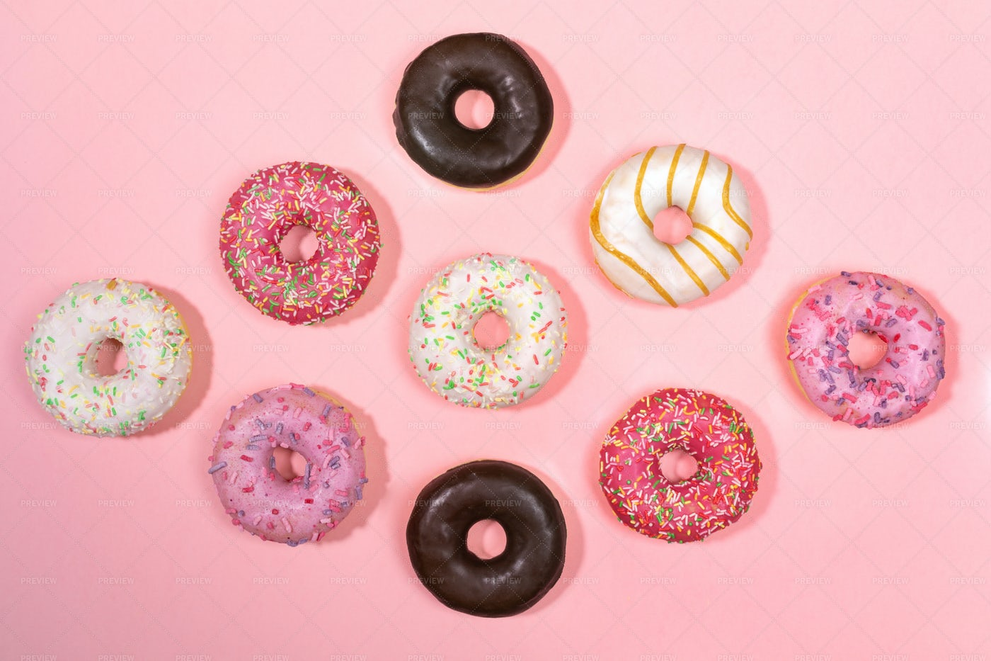 Traditional Doughnuts On Pink.: Stock Photos