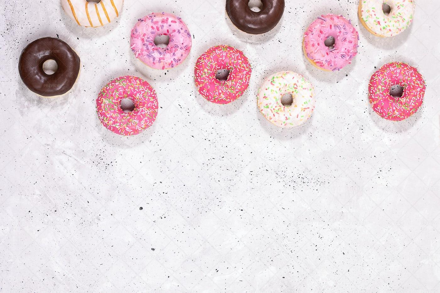 Top View Doughnuts On Concrete.: Stock Photos