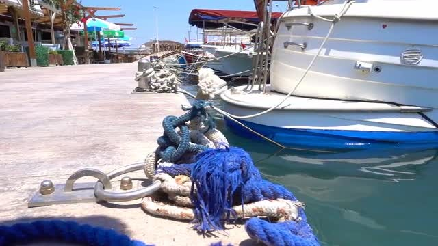 Boat Tied To Port Bollard: Stock Video