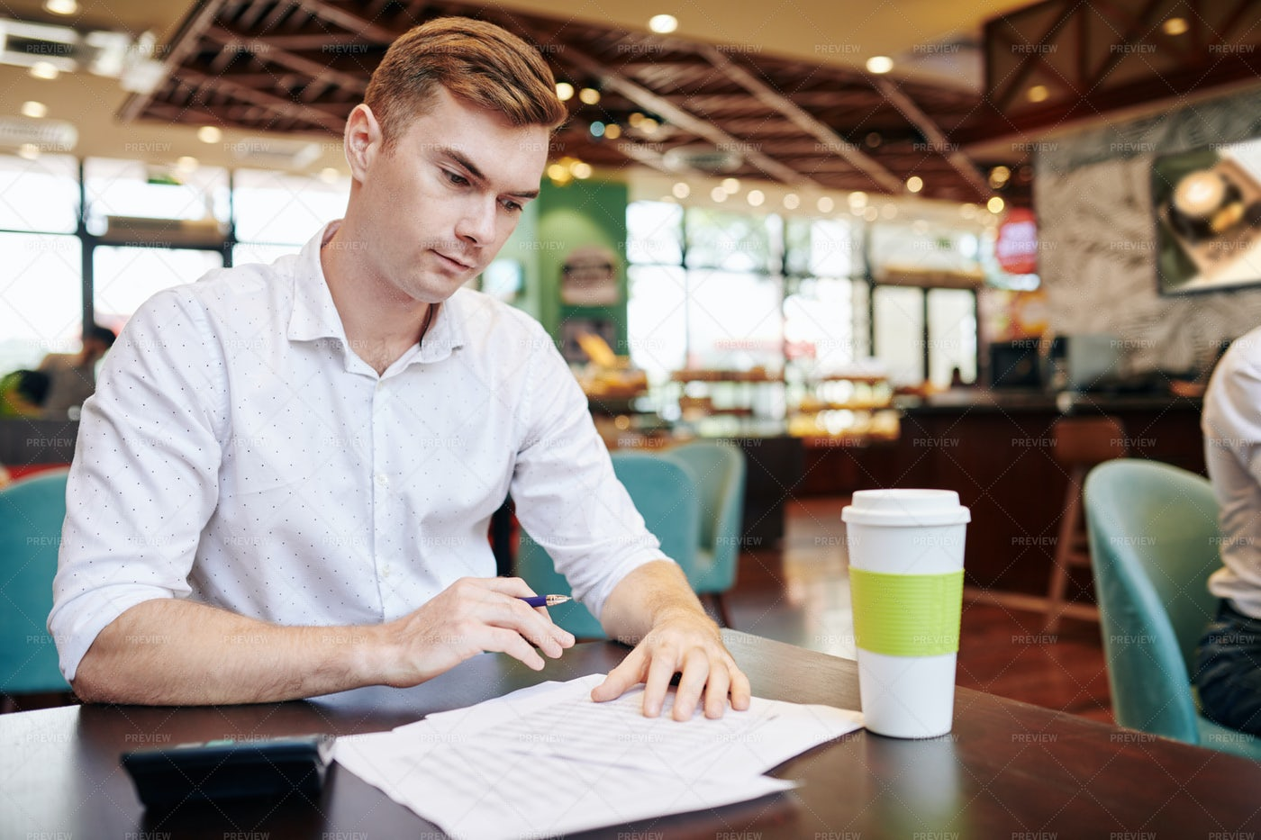 Young Businessman Checking Report: Stock Photos