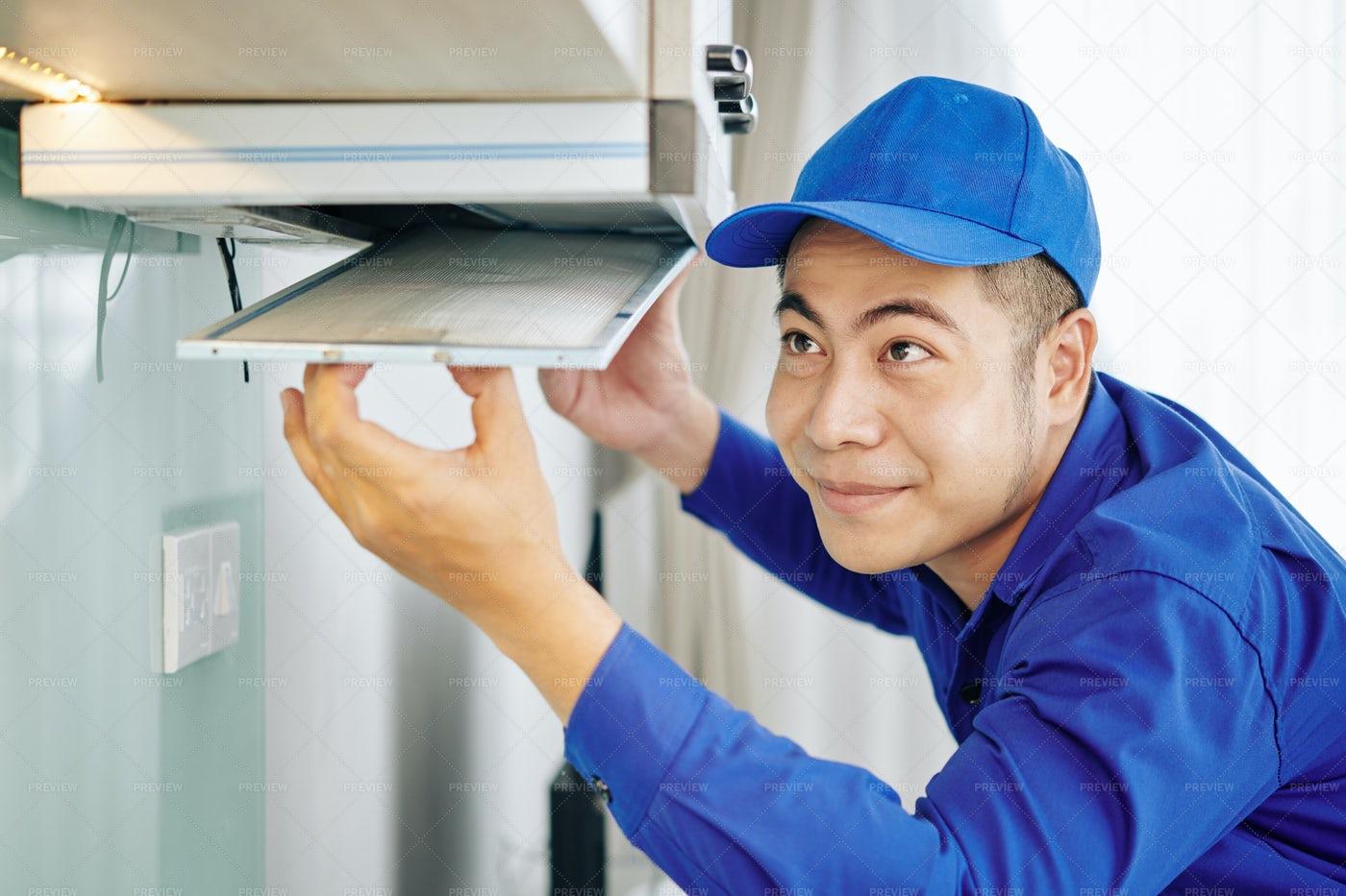 Worker Installing Cooker Hood: Stock Photos