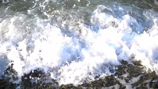 Waves Closeup Foaming On Rocks: Stock Video