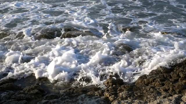 Foamy Waves Climb Seaside Rocks : Stock Video