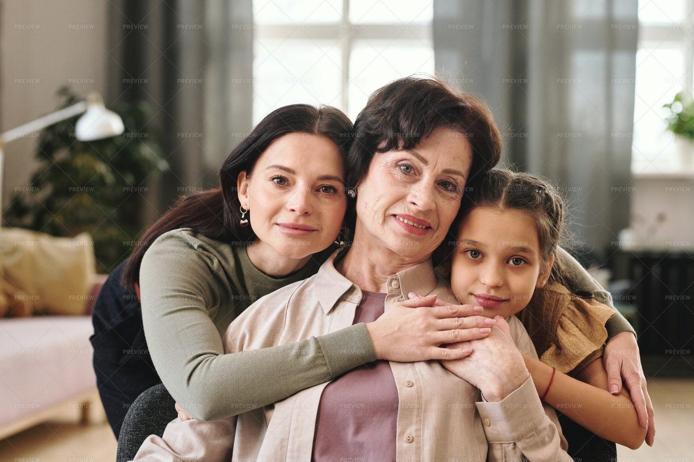Women Of Three Generations Hugging: Stock Photos