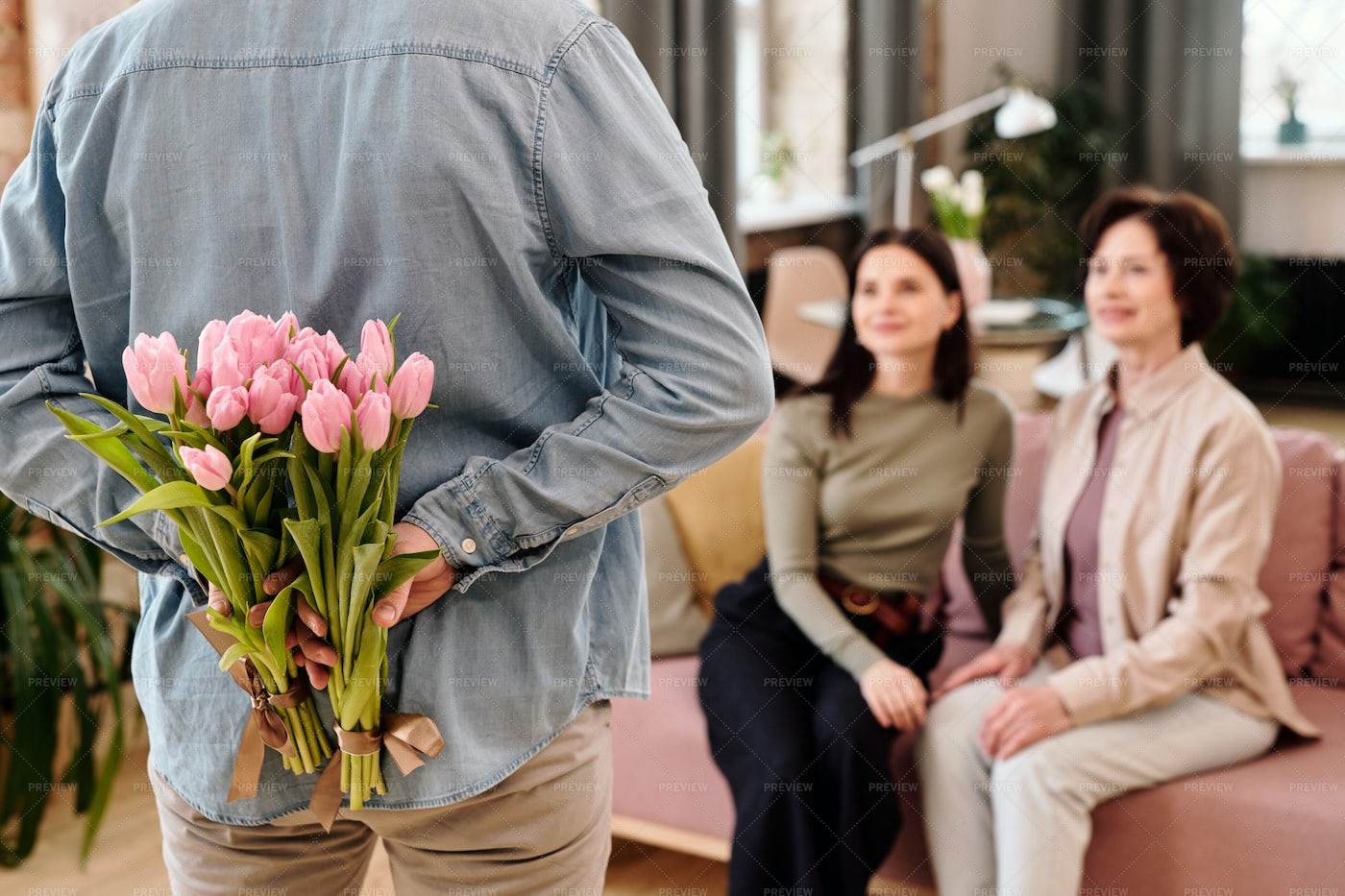 Man Giving Flowers To Females: Stock Photos