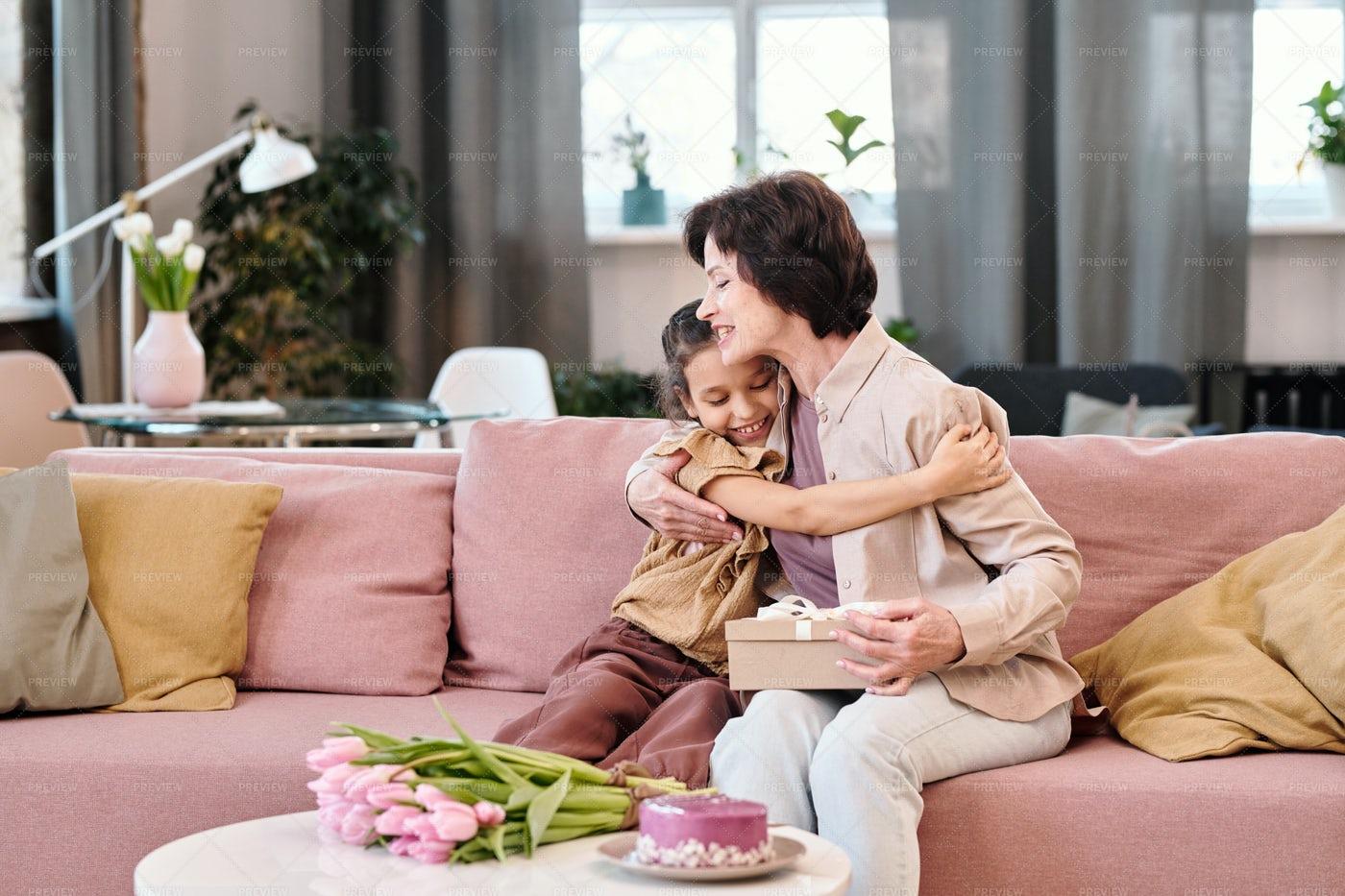 Little Girl Embracing Grandmother: Stock Photos