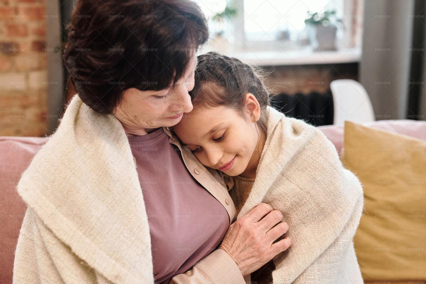 Cute Little Girl Embracing Grandmother: Stock Photos