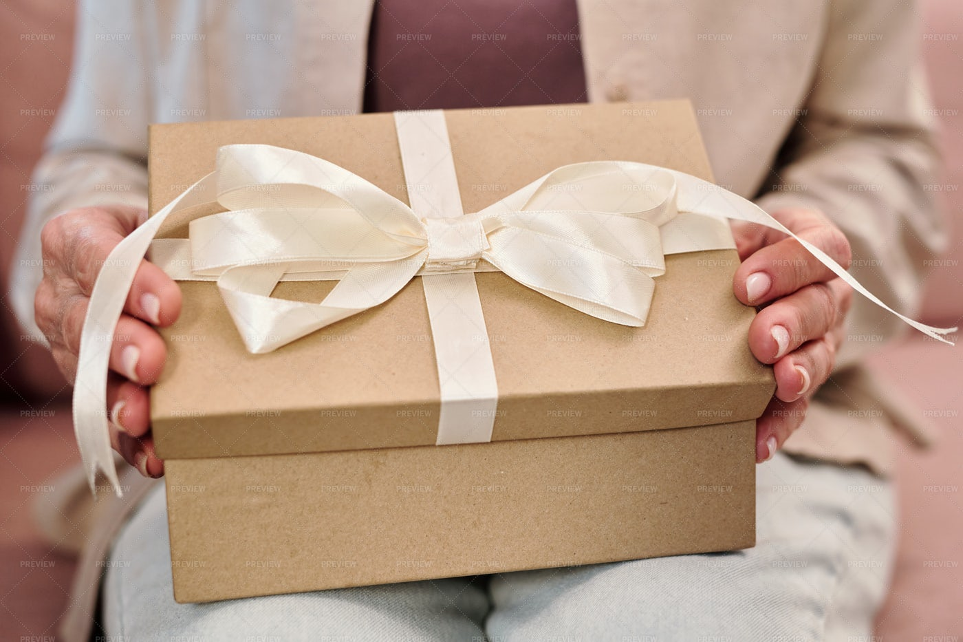Hands Of Female Opening Present: Stock Photos