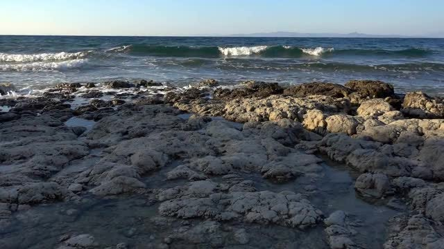 Ocean Waves Approaching Rocky Shoreline: Stock Video
