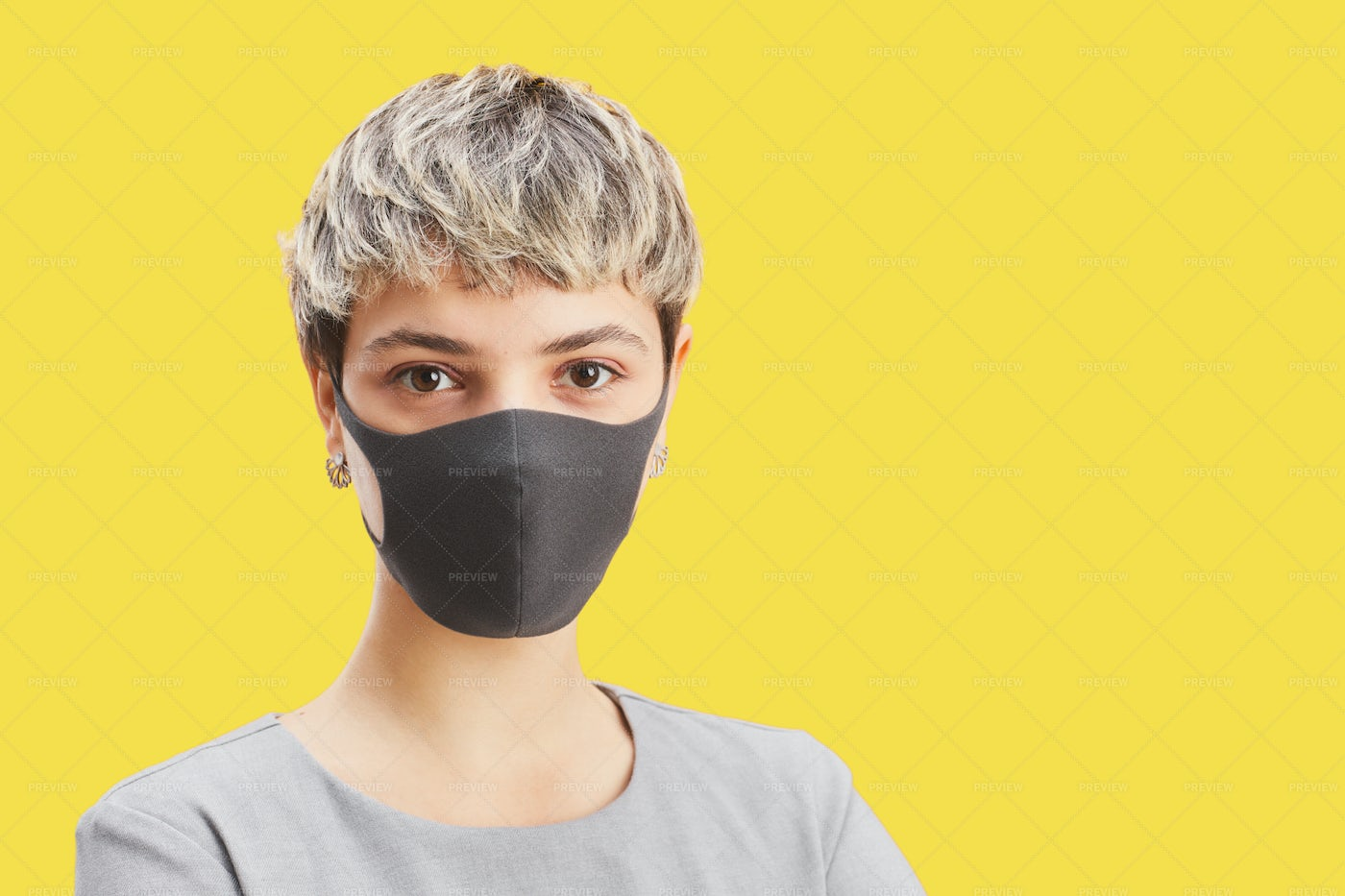 Young Person Wearing Mask On Yellow: Stock Photos