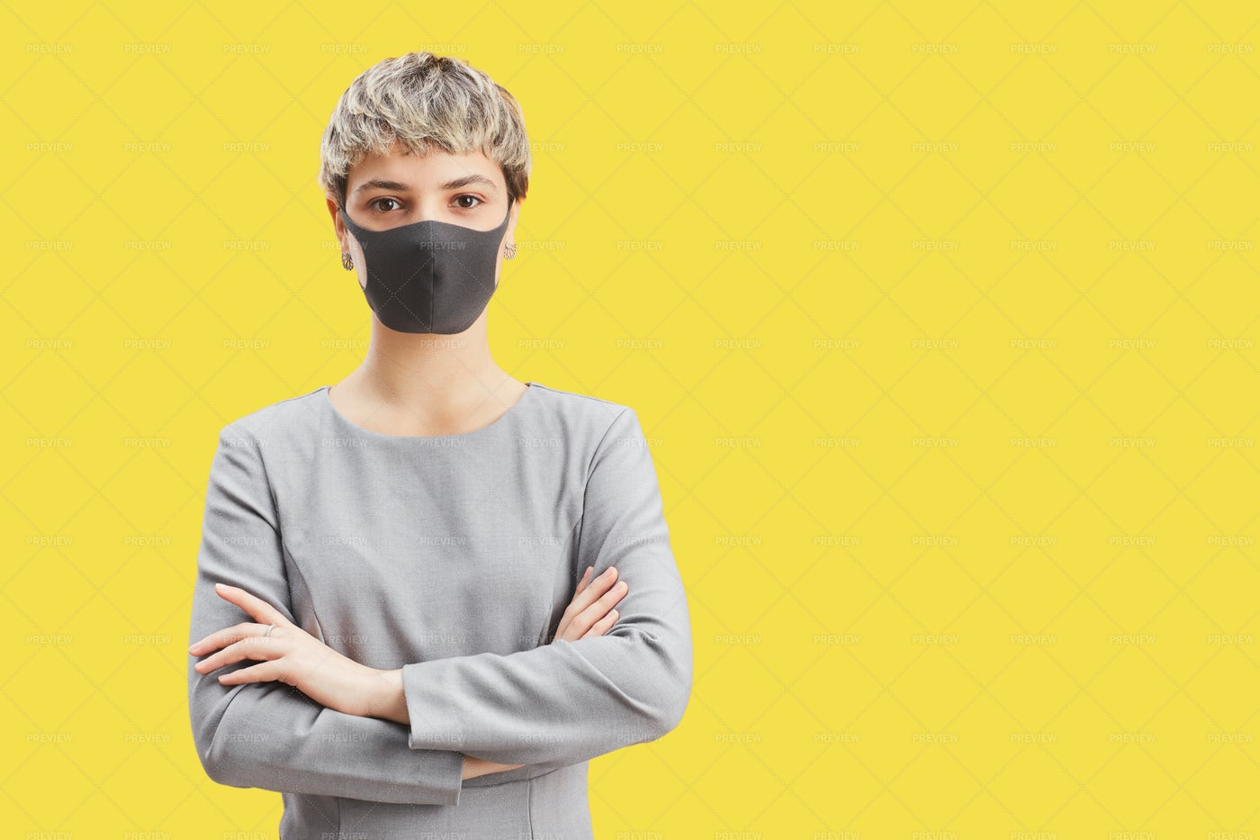 Young Woman Wearing Mask On Yellow: Stock Photos