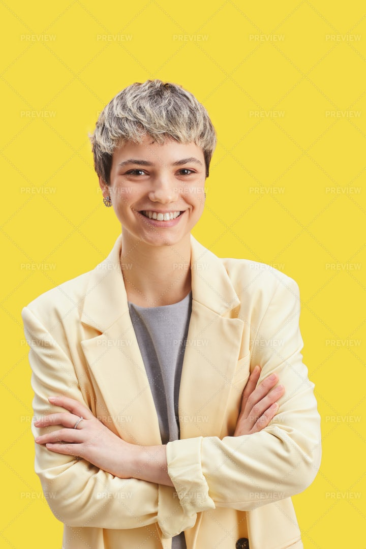Smiling Young Woman On Yellow: Stock Photos