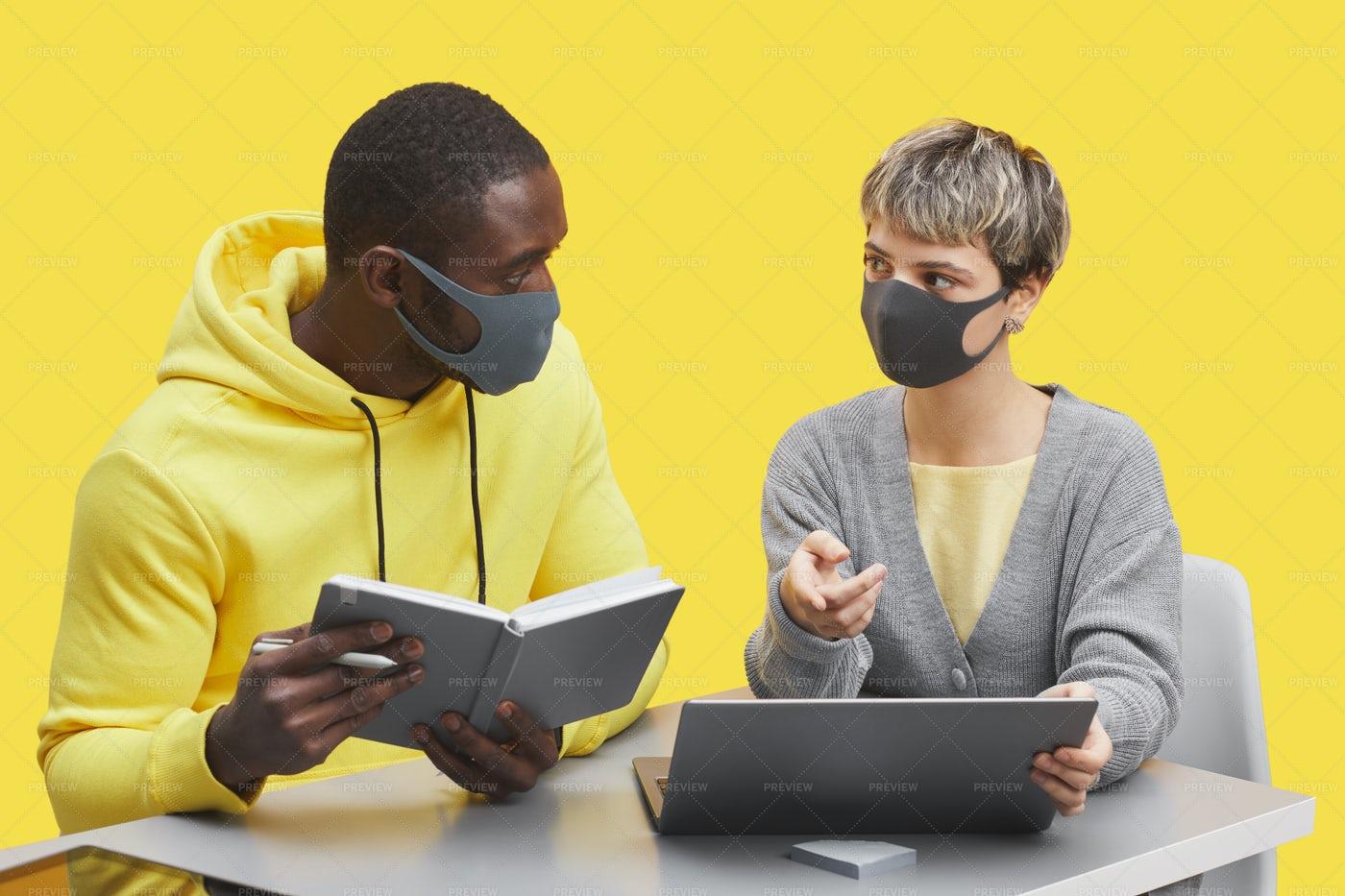 Creative Team Wearing Masks On Yellow: Stock Photos