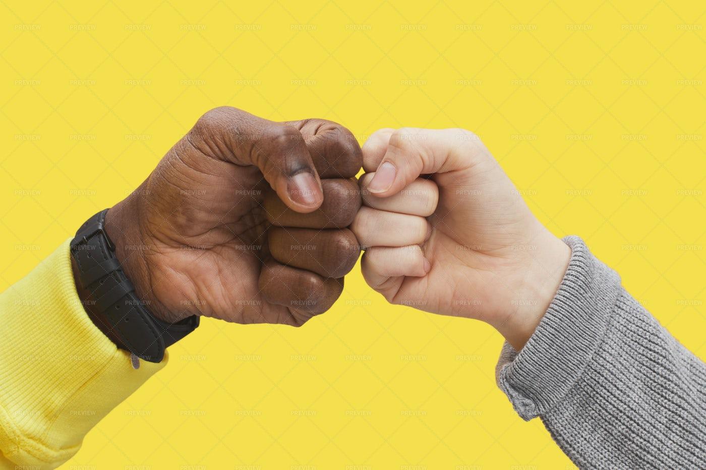 Bumping Fists: Stock Photos