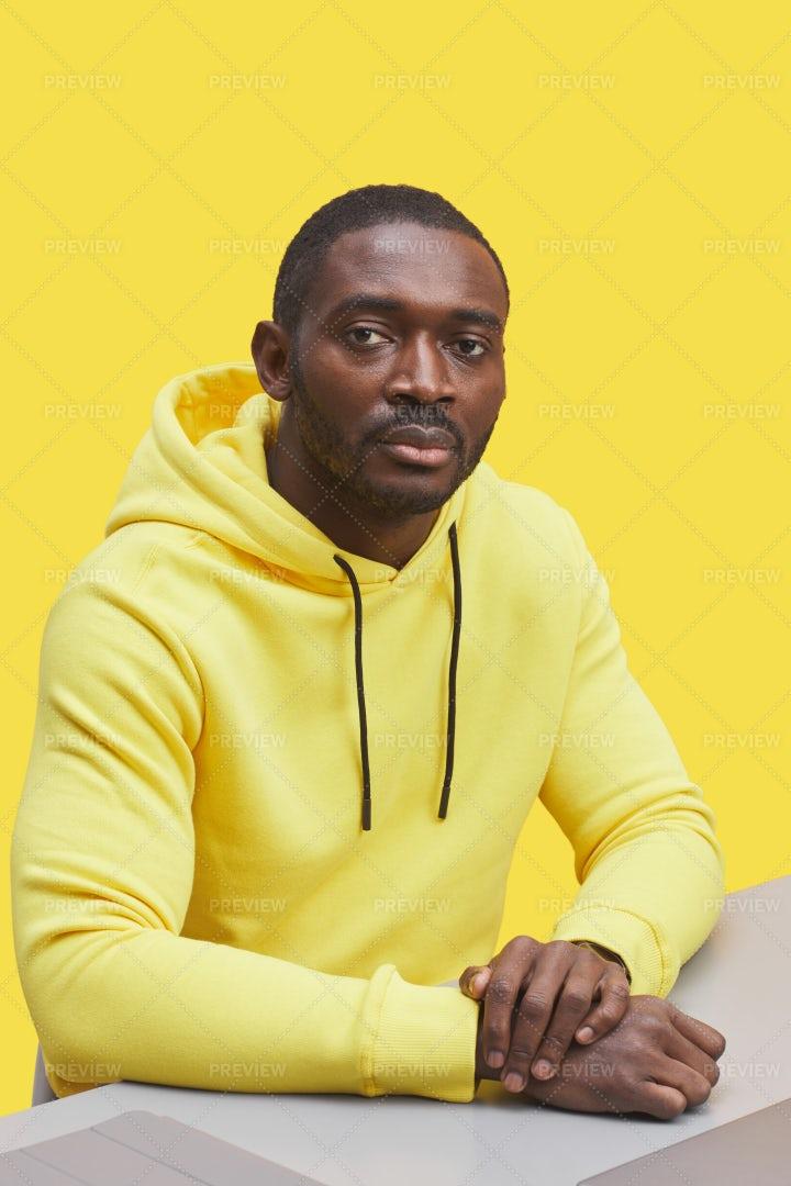 Man Wearing Hoodie On Yellow: Stock Photos