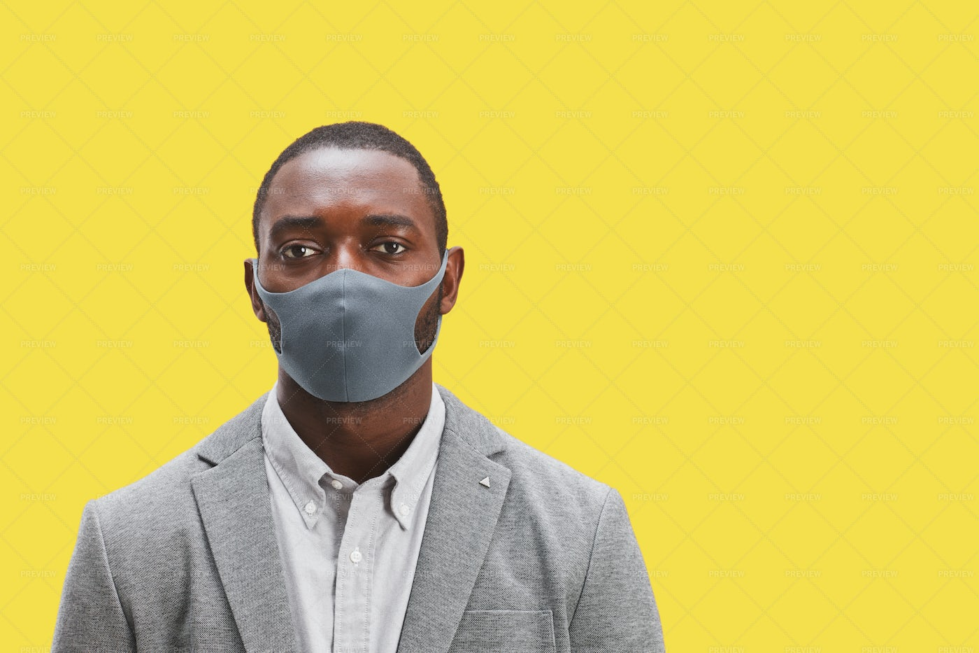 Manager Wearing Mask On Yellow: Stock Photos
