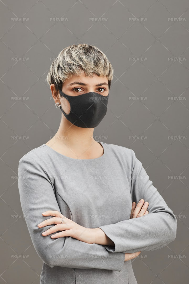 Confident Businesswoman Wearing Mask On: Stock Photos
