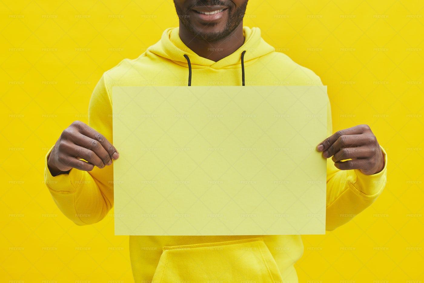 Man Holding Yellow Paper: Stock Photos