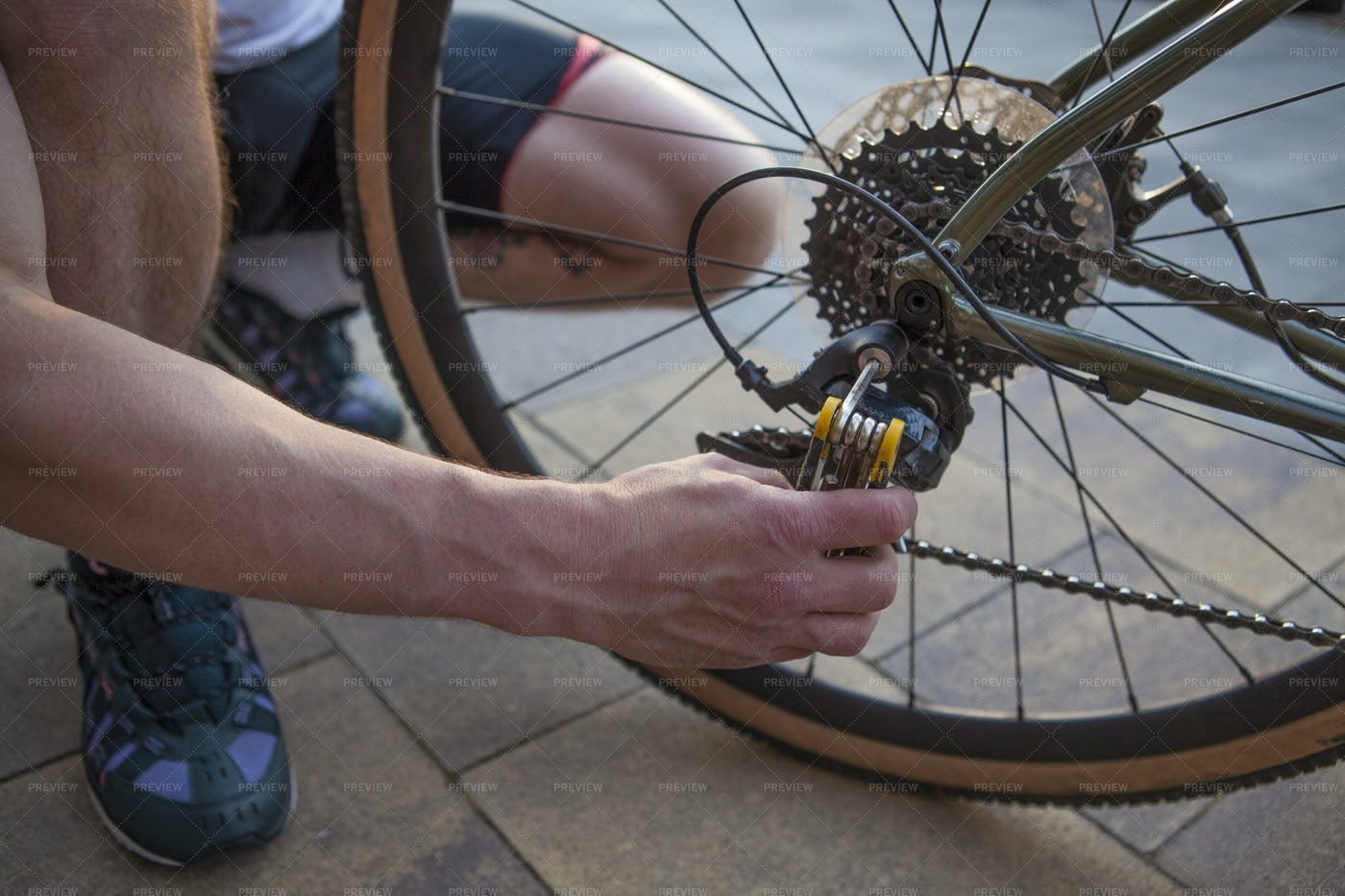 Cyclist Fixing His Bicycle: Stock Photos