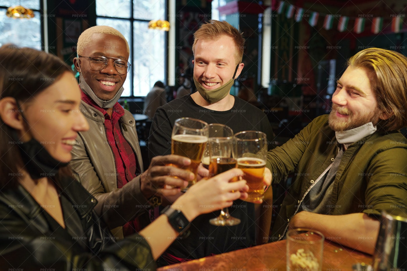 Football Fans Clinking Beer Glasses: Stock Photos