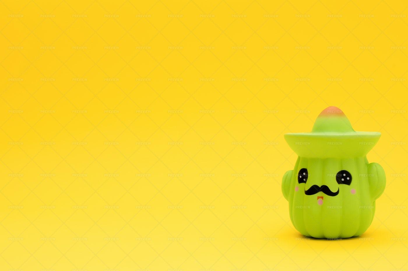 Toy Cactus In Sombrero On Yellow: Stock Photos