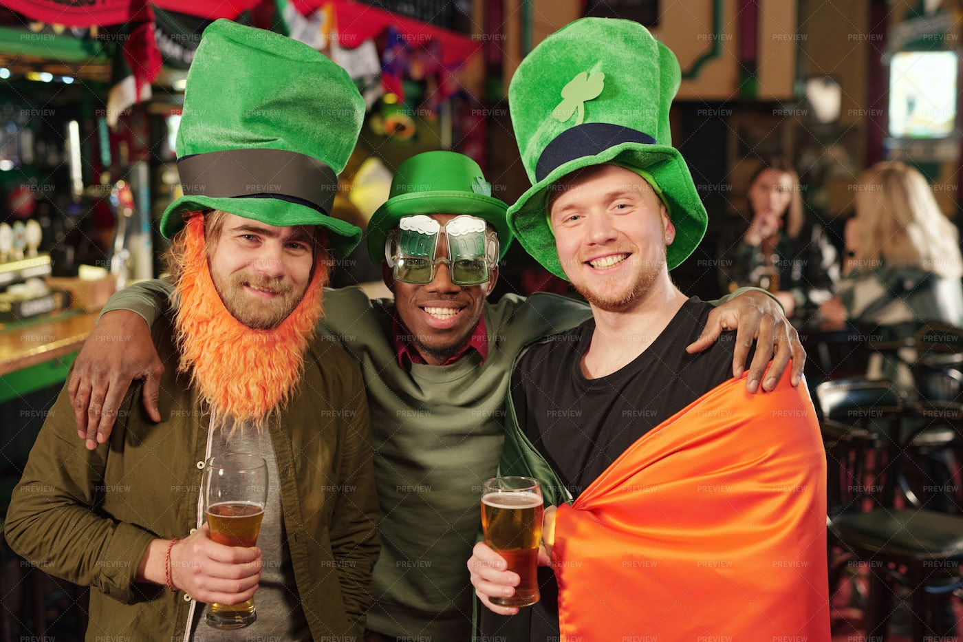 Young Men With Beer In Pub: Stock Photos