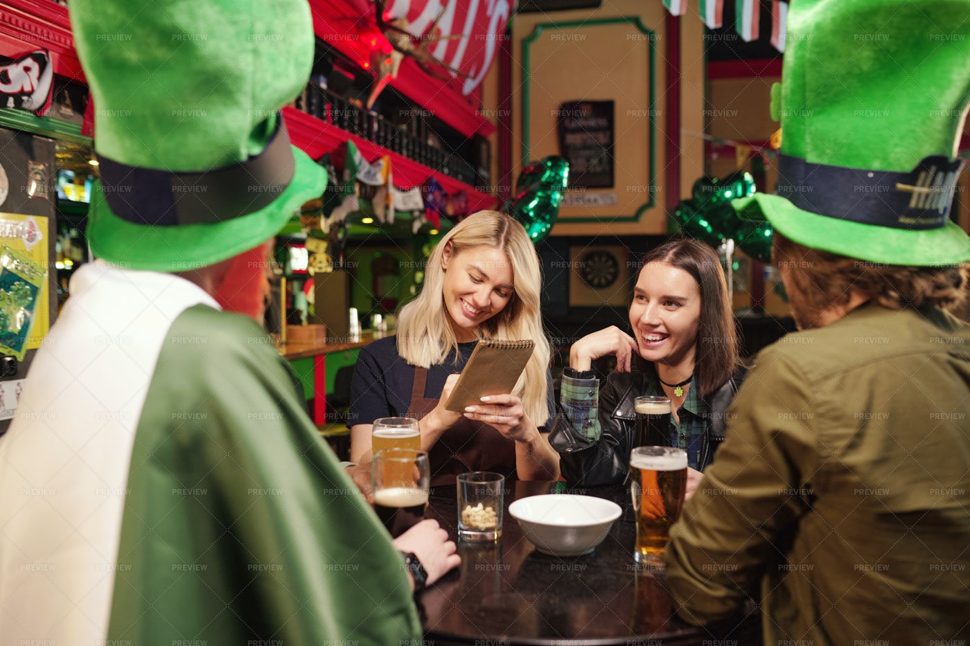 Group Of Friends In Irish Pub: Stock Photos
