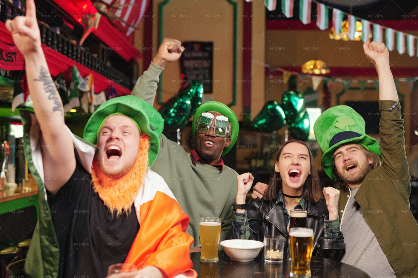 Group Of Excited Football Fans In Pub: Stock Photos