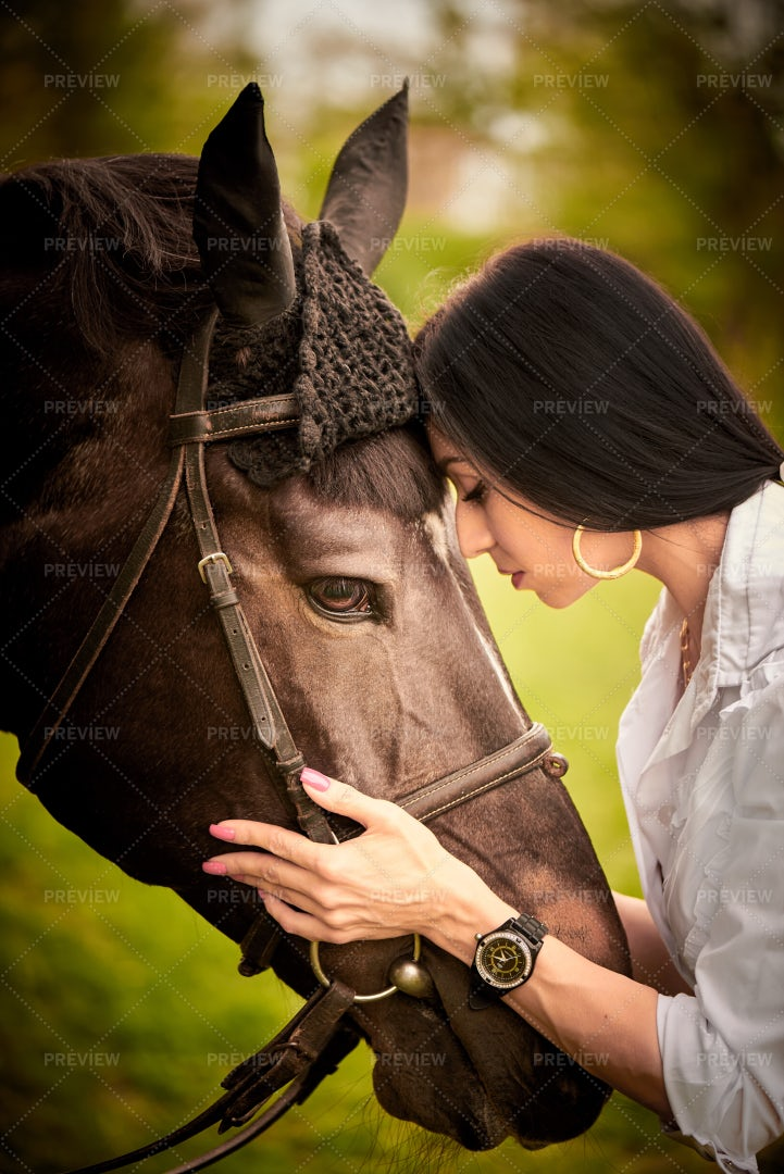 A Young Woman Hugs A Horse: Stock Photos