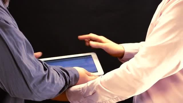 Tablet Sharing Among Work Colleagues : Stock Video